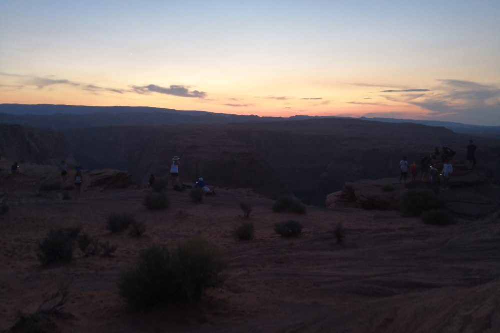 People enjoying the sunset at the edge of the famous landmark in Page, Arizona
