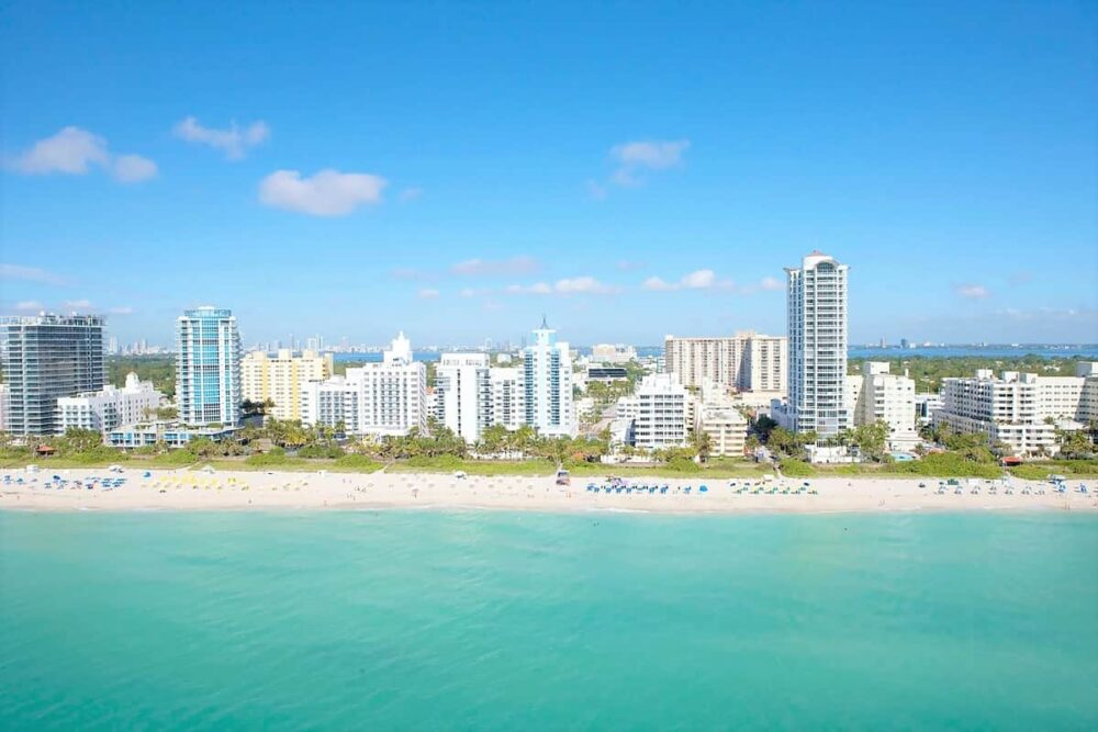 White beach and blue water in Miami