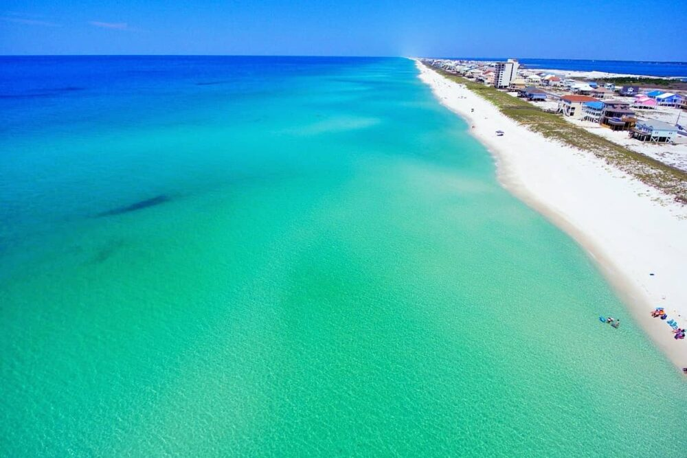Crystal clear water and white sand on Pensacola Beach.