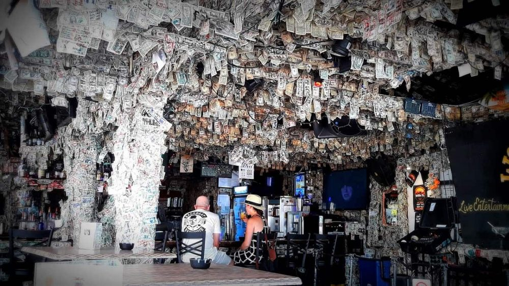 Bar with dollar bills on ceiling