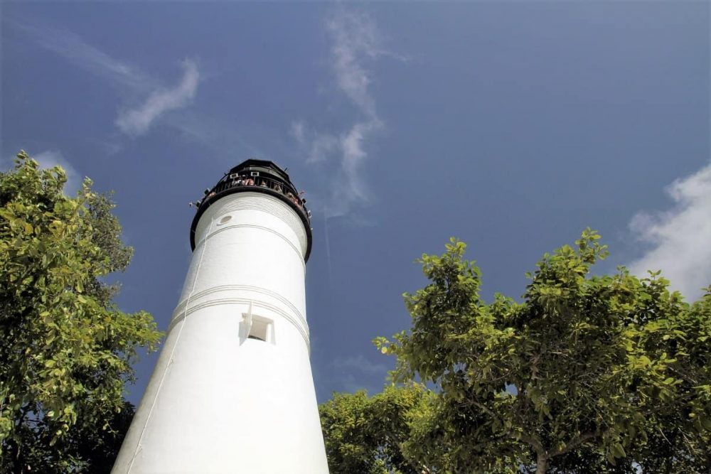 Lighthouse and blue sky during daytime.