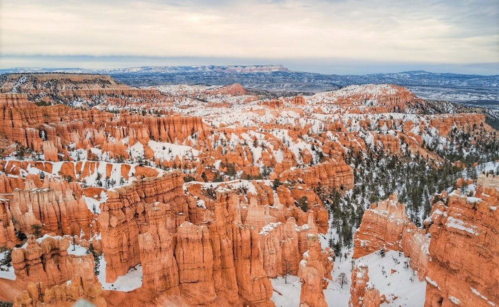 Red rock hoodoos covered by white snow