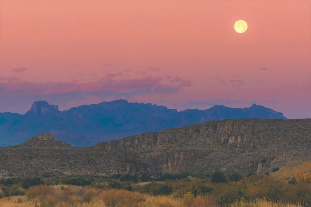 Full moon over mountains in Big Bend National Park, Texas