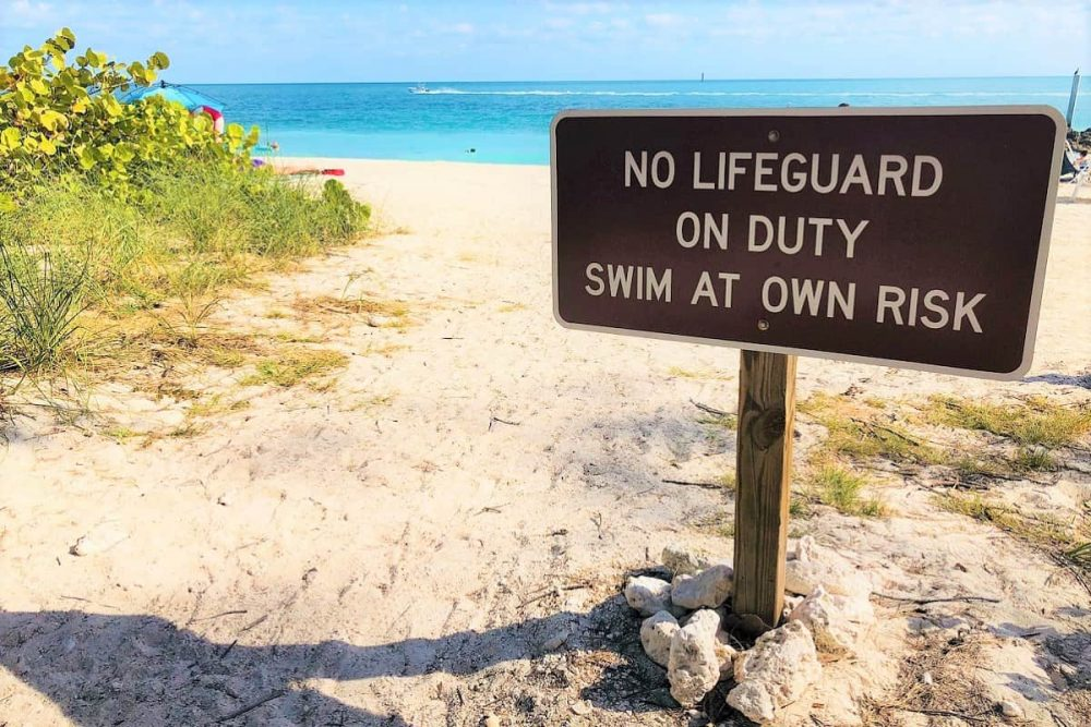 Sign on FLorida Keys beach warning that no lifeguard is on duty
