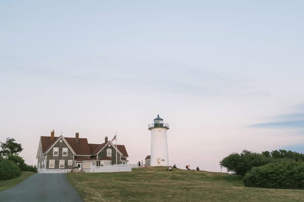 House and lighthouse at sunset