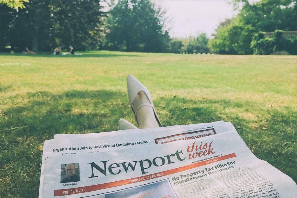Newspaper on green mansion lawn in Newport, Rhode Island