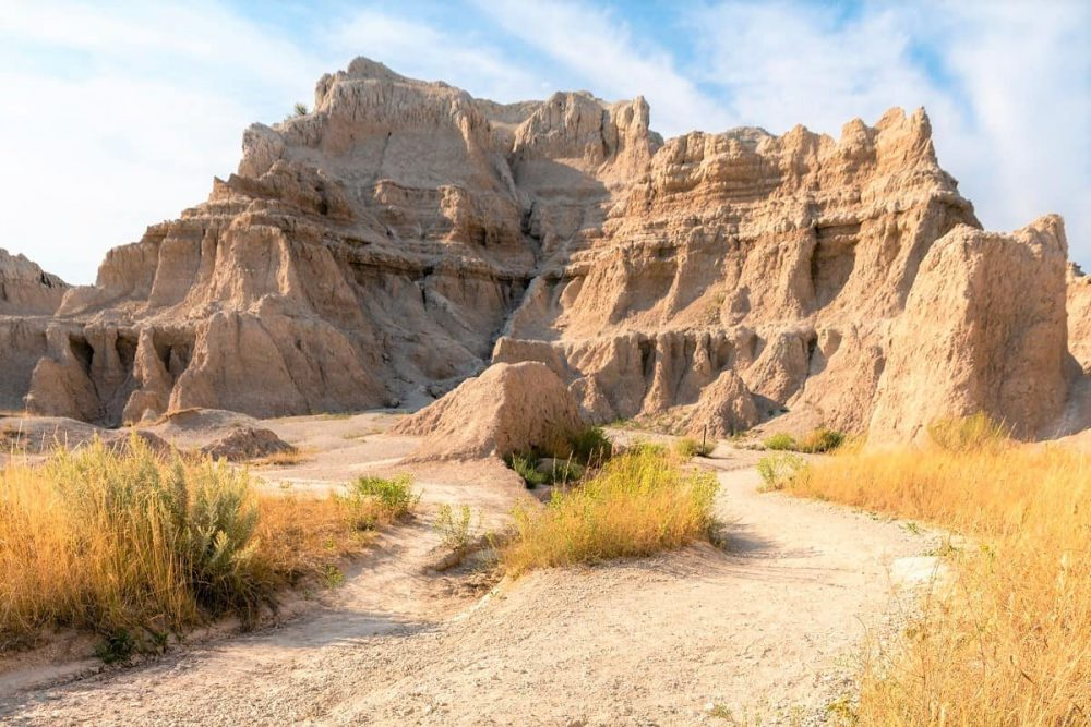 Rock formation and yellow grass in Badlands National Park, SD