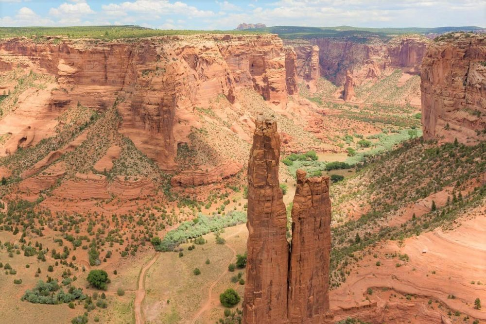 Red rocks and green vegetation in Canyon de Chelly National Monument in Arizona